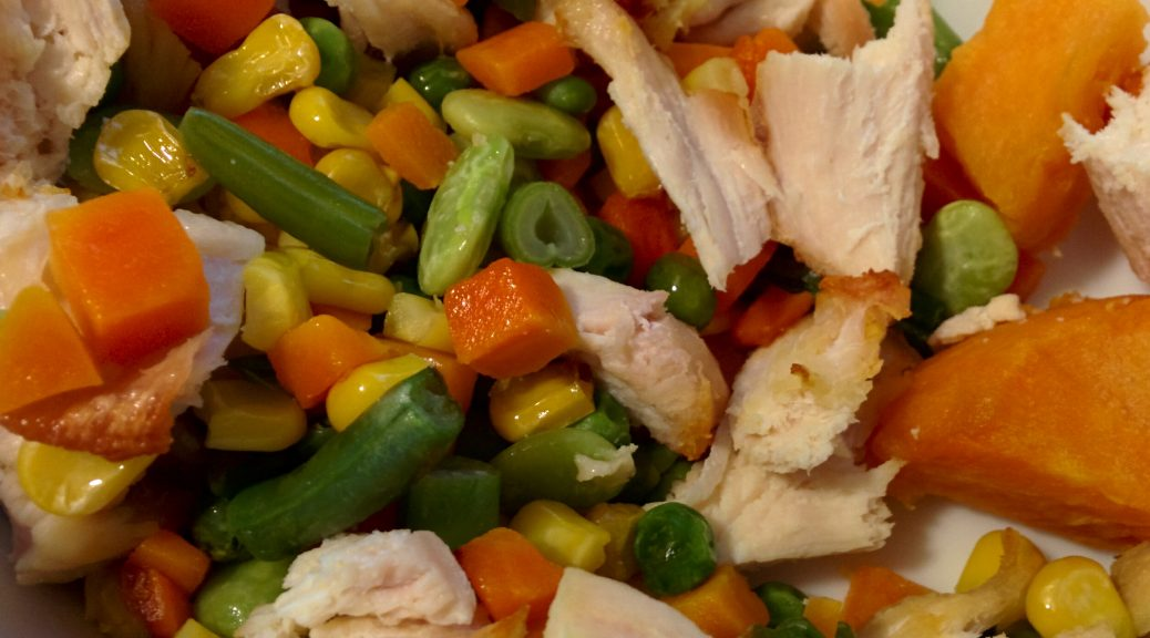 Mixture of corn, peas, carrots, sweet potatoes and chicken.